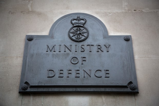 Outside the building of the Ministry of Defence, focusing on the plaque outside saying the name of the department