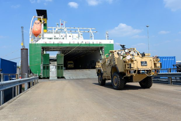 A Jackal armoured vehicle returns from Afghanistan disembarking from a merchant vessel at Marchwood, Hampshire. Military Vehicles and equipment from Afghanistan arrived on merchant ship EDDYSTONE at the Sea Mounting Centre in Marchwood (Military Port), ready for the Roll On Roll Off load operation. Elements from 17 Port and Maritime Squadron helped in the unloading process. As of 31 May 2013, the UK has redeployed 625 vehicles (18.7%), major equipment and 1080 (19.7%) twenty foot equivalent units of materiel from Afghanistan. The Uk does not underestimate the scale of the effort that is required. Considerable work and personnel are in place to support it. Image: A JACKAL armoured vehicle being un loaded from the EDDYSTONE Photographer: Cpl Lu Scott
